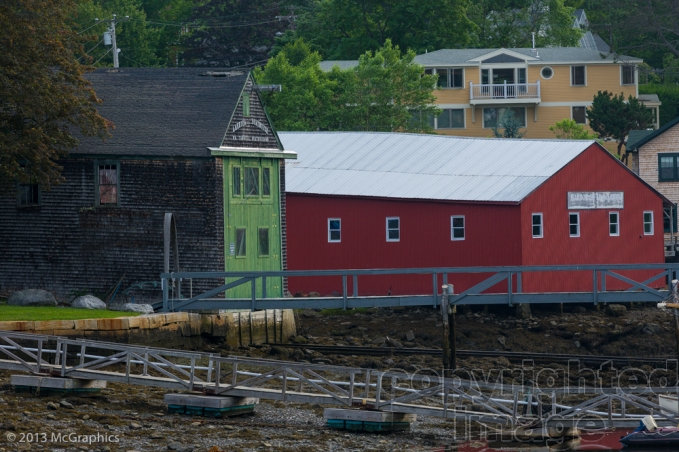 Boat repair buildings on the shore at Camden, Maine.